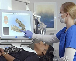 Dentist showing patient digital dental impressions
