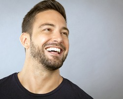 Man smiling after periodontal therapy