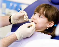 Young girl receiving dental exam