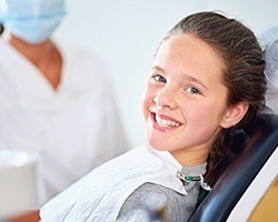 Young girl smiling in dental chair