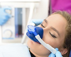 Female dental patient with nitrous oxide nose mask