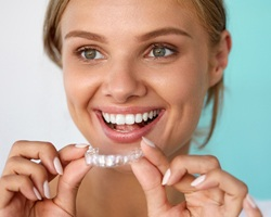 Woman putting in a whitening tray