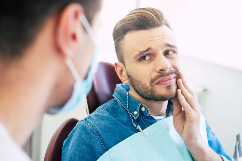 Man seeking emergency dentistry for dental injury