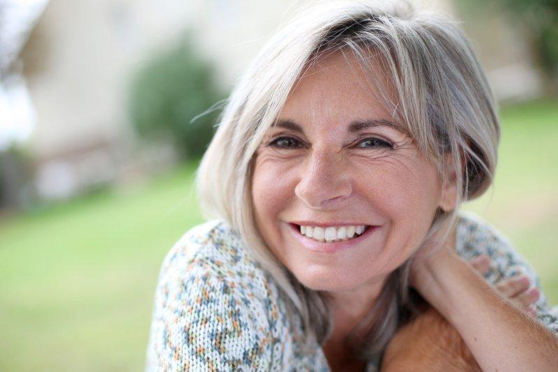 Closeup of senior woman smiling outside